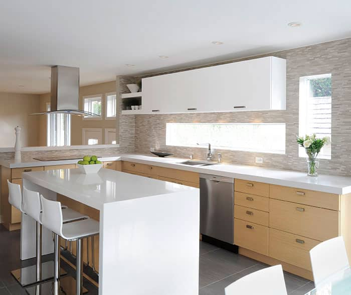 remodeled kitchen in light, natural colors with two-toned cabinetry, white upper cabinets and light wood lower cabinets