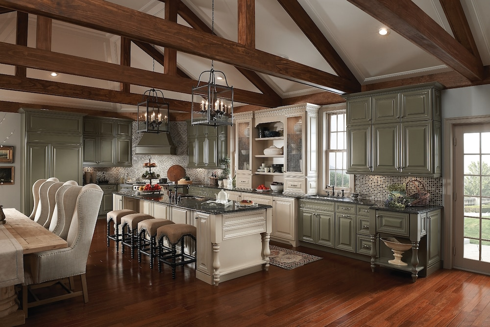 remodeled kitchen with exposed beams and kraftmaid cabinetry painted in two tones