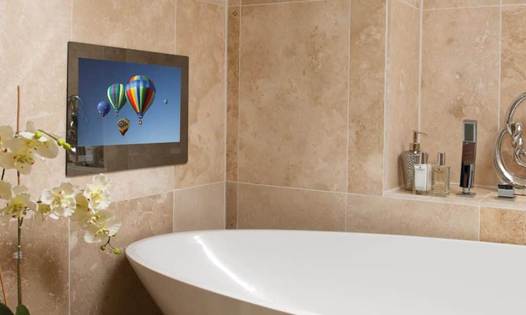 built-in tv next to standing tub in remodeled bathroom