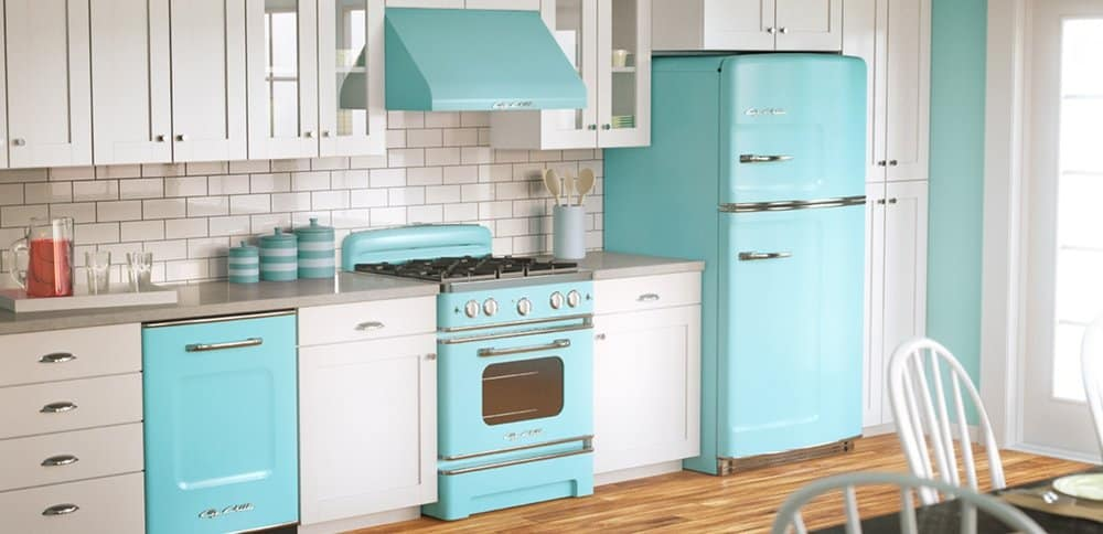 remodeled kitchen with white cabinets and subway tile backsplash, grey countertops, and turquoise retro appliances
