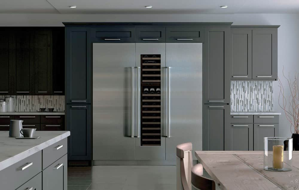 remodeled kitchen and large stainless steel refrigerator with column and glass doors