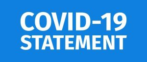 blue background with covid 19 statement in white letters