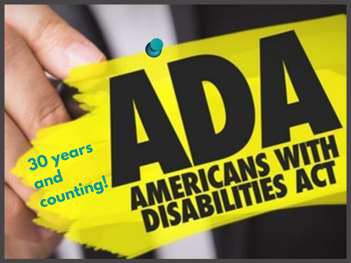 male hand highlighting  the words ADA Americans with Disabilities Act in yellow