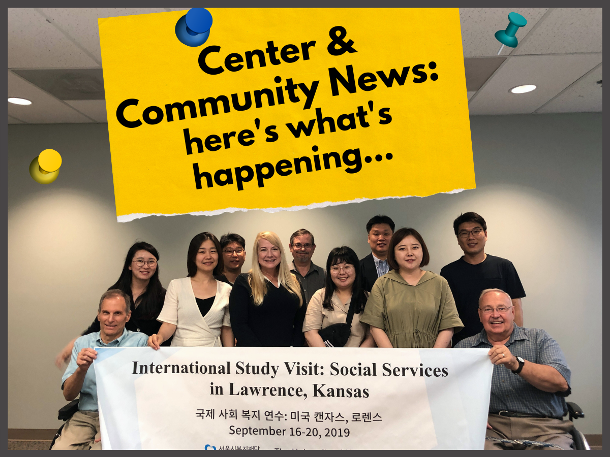 A group of social services students from Korea pose for a group picture with Independence, Inc. staff in a conference room setting