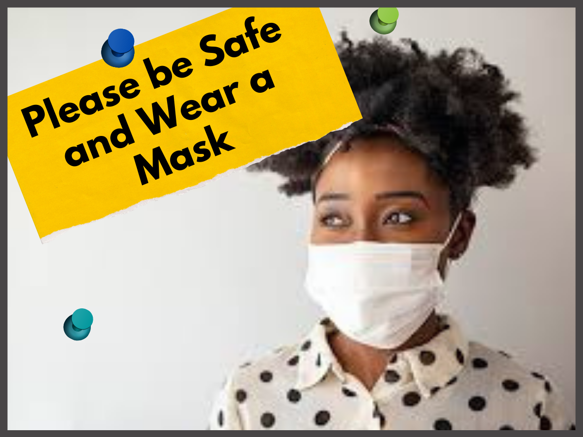 young woman with dark skin wearing black and white polka dot shirt and a white face mask