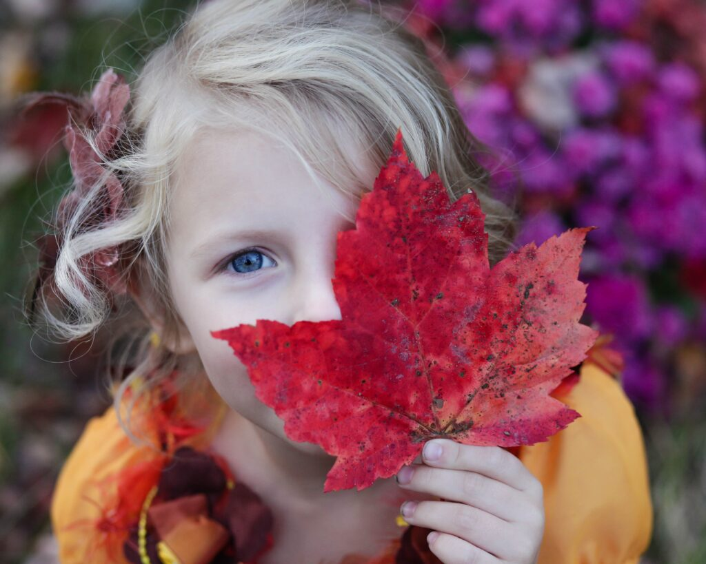 little girl with a leaf