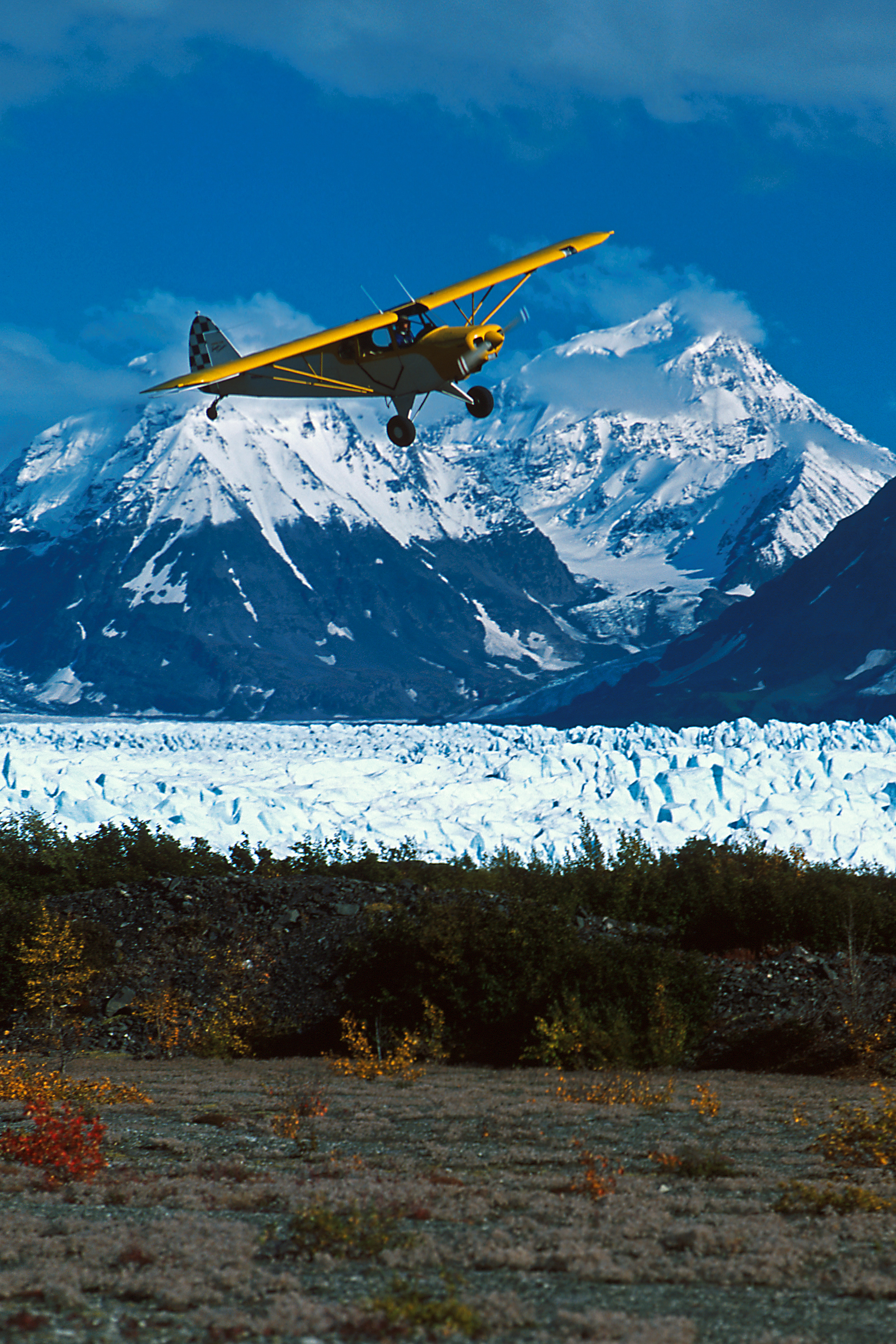 Alaska bush plane landing at Knik Glacier Picknick Table Strip, Alaska, Knik Glacier, near Palmer