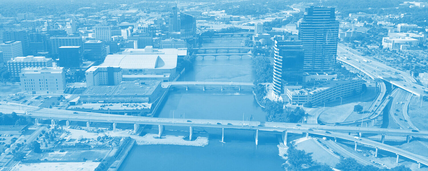 Aerial photograph of the Grand River in downtown Grand Rapids, with a blue filter overlay.