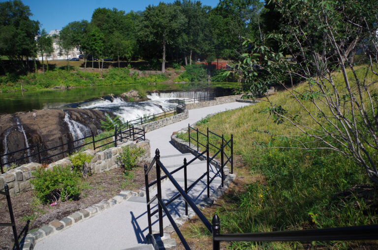 A photograph showing the steps and pathway leading to the falls observation area. The Falls can be seen in the background.