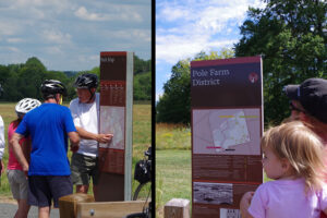 A collage of two images. The left image shows a man with his finger on the overall park map, seeming to discuss with his companions where they will go next. The image on the right shows a man holding a young child looking at the detailed map for the Pole Farm District.
