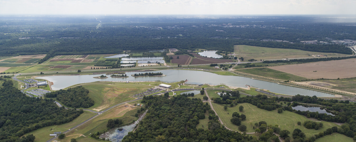 Aerial birds-eye view of the lake and the Heart of the Park project.