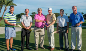 The celebrate the opening of the redesigned championship golf course, executives of The Naples Beach Hotel & Golf Club are seen here during the ceremonial ribbon-cutting. Pictured from the resort are (from left):  Golf Course Grounds Superintendent Holden Jones, General Manager Jason Parsons, Co-Owner of the resort Henry B. Watkins III, Co-Owner and President of the resort Michael Watkins, Vice President Azi Azami, and Head Golf Professional and Director of Golf George Willard.