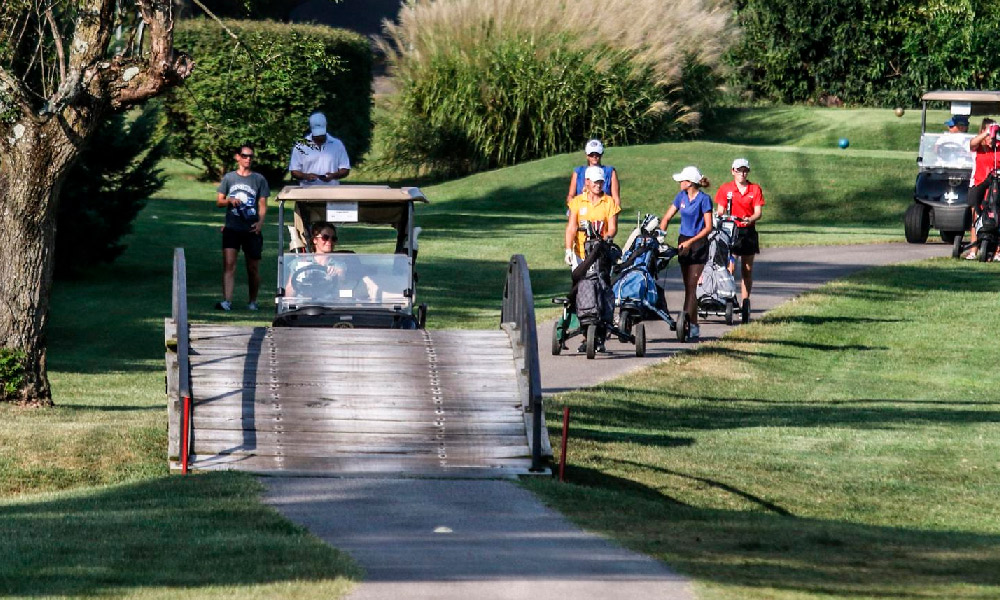 Golfers make their way along the course at Owensboro Country Club