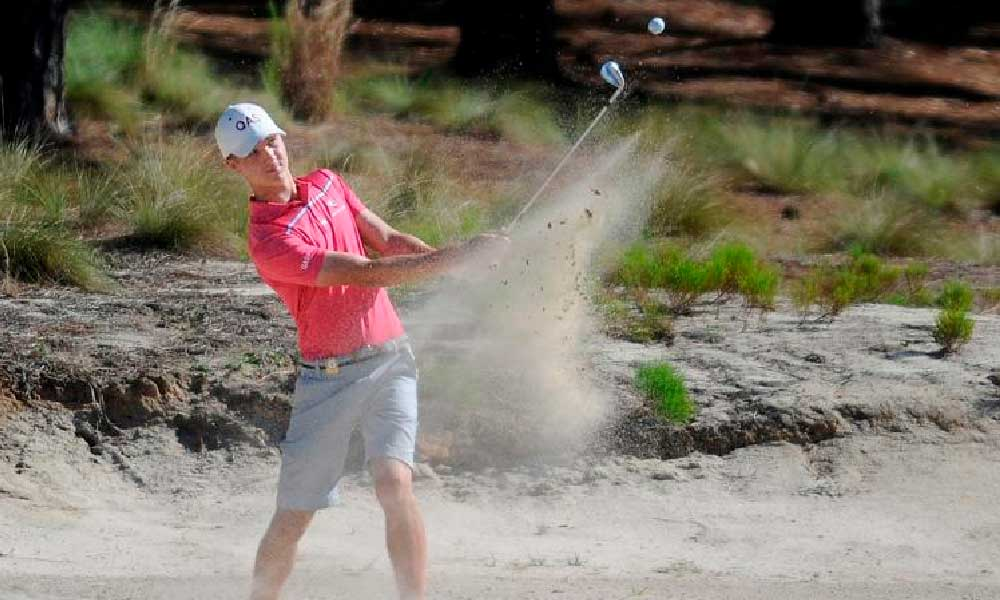Louis Dobbelaar from Australia hits out of the sand in the first round at the North & South Championship at Pinehurst No. 2, June 2017. Ted Fitzgerald/The Pilot