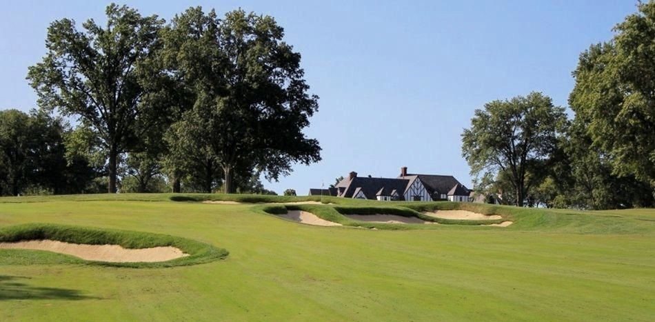 Kenwood's iconic Tudor-style clubhouse rises behind the newly renovated and dramatically re-bunkered 4th green.