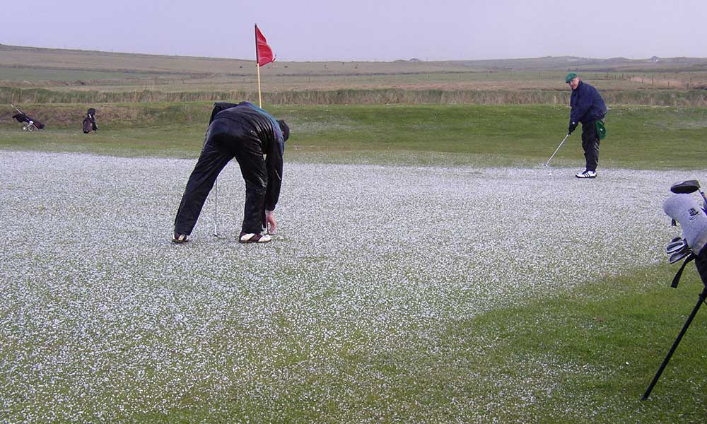 On a 2002 Dr. Joe Gruss Gets Ready to Putt through the Hail (Photo Courtesy of Dr. Bryan Williams)