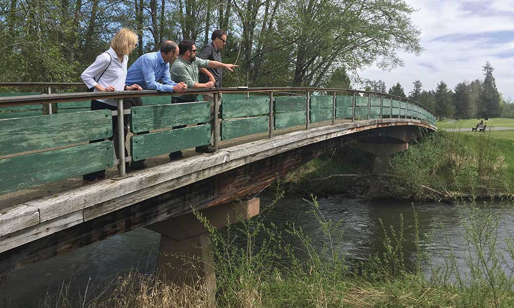The Salmon-Safe science team with Dan Smith of the City of Tumwater on a bridge spanning the Deschutes River at Tumwater Valley Golf Club