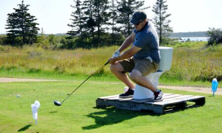 Teeing off while sitting on a toilet bowl was just one of the challenges awaiting golfers at the River Hills Golf and Country Club in Clyde River during the first-ever Superintendent Revenge Scramble on Sept. 22. - Kathy Johnson