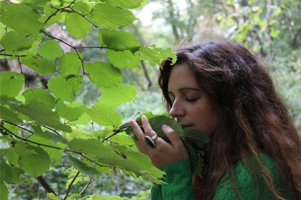 Ruth smelling a leaf during forest bathing