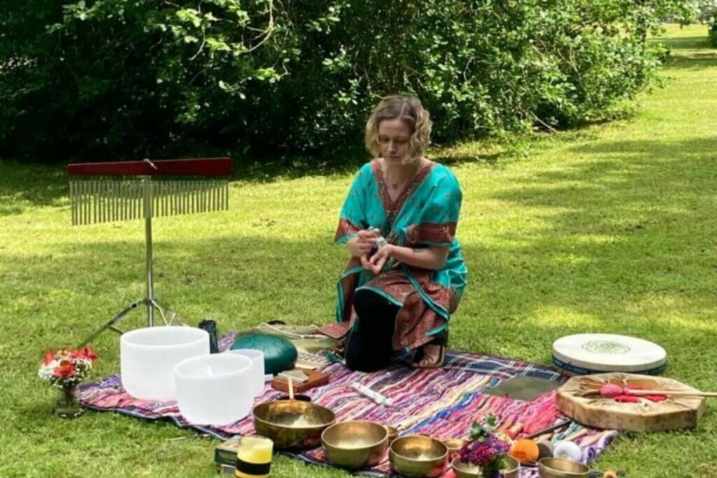 Olga, a sound healing therapist, in action