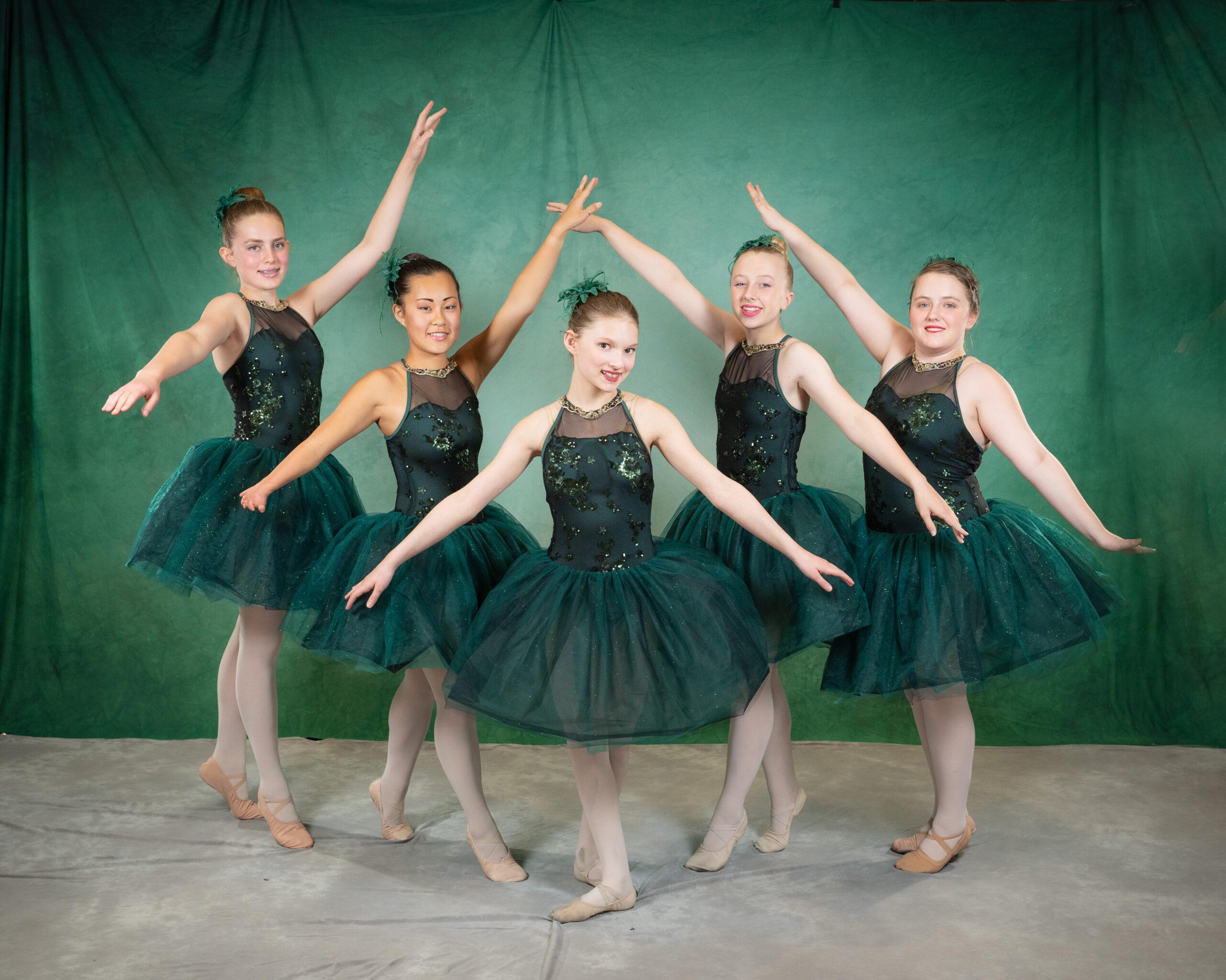 Ballet dancers in emerald green costumes