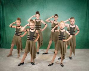 Jazz dancers in light green costumes
