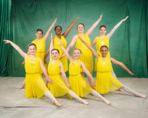 Lyrical dancers in yellow costumes