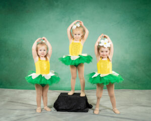 3 little dancers in sunflower costumes