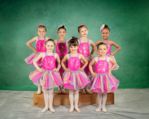 7 little dancers in pink costumes