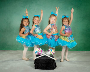 4 little dancers in candy costumes