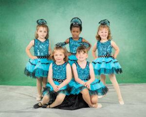 5 little dancers wearing blue costumes