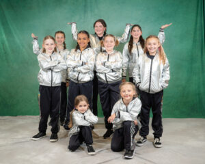 Hip Hop dancers in silver costumes