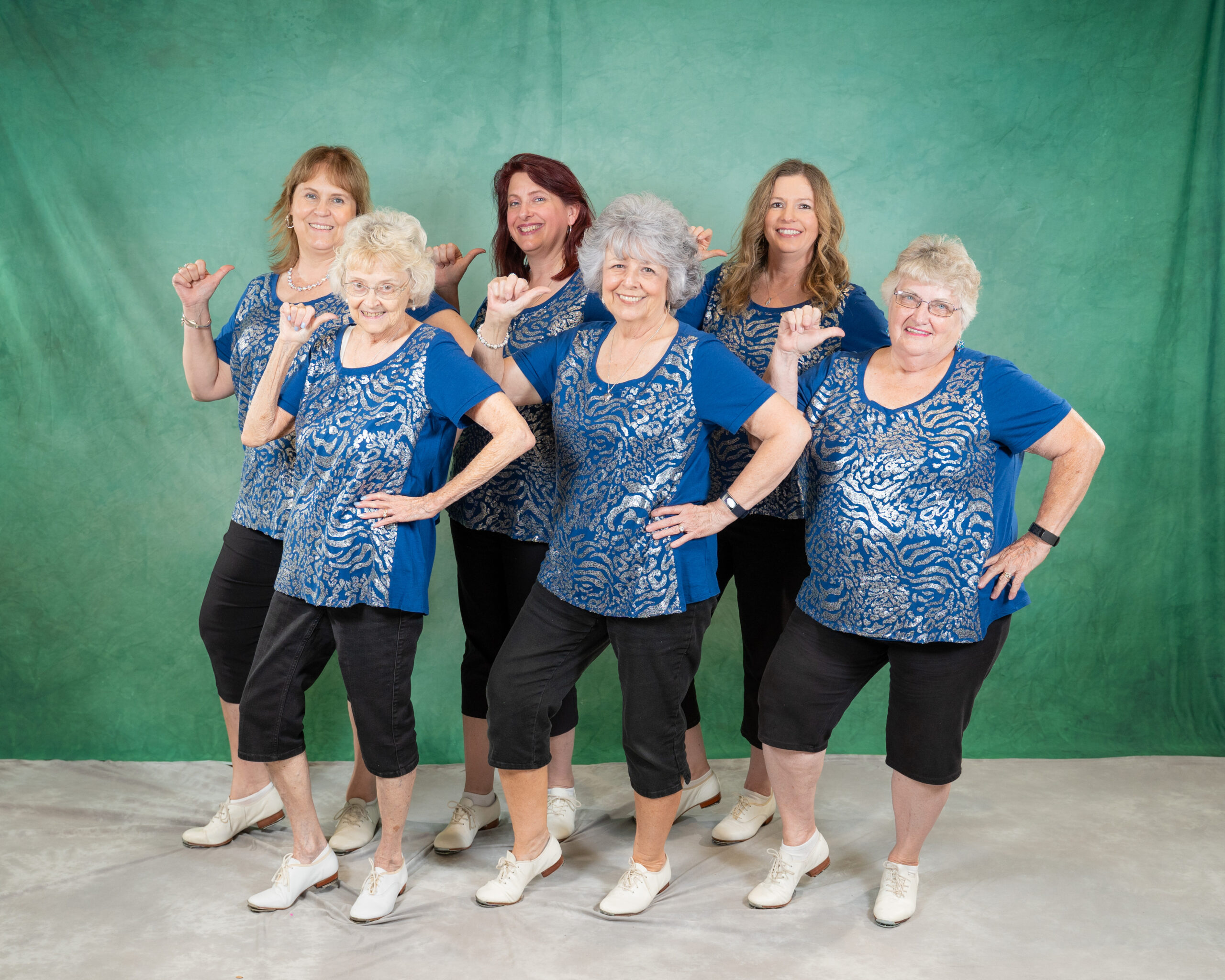 adult cloggers in blue costumes