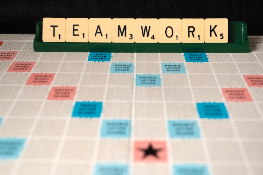 """Photo of Scrabble Board that reads out """"Teamwork."""""""