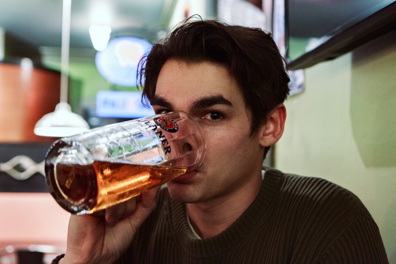 Man drinking beer for story about alcohol at the workplace