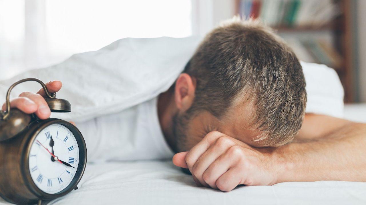 Photo of man sleeping, illustrating shift work.