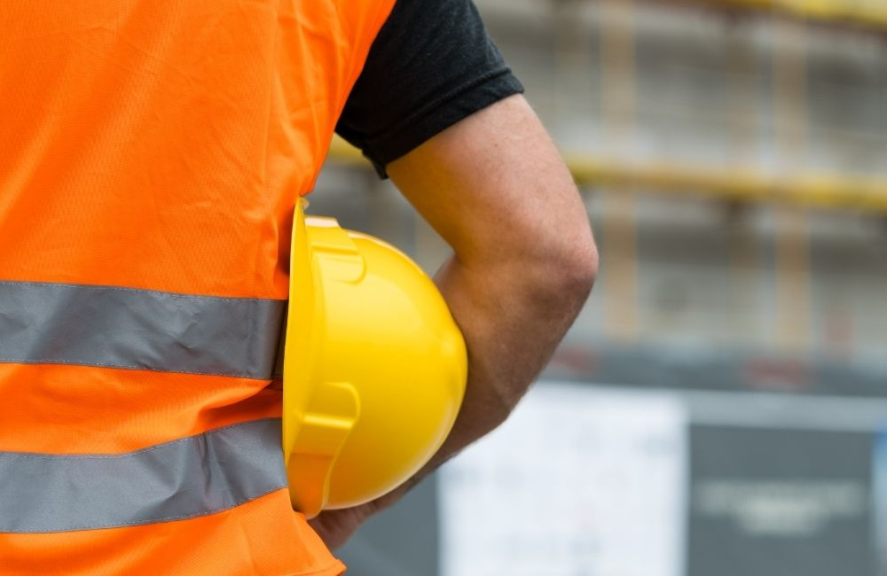 Photo of man with hardhat to illustrate safety training tips