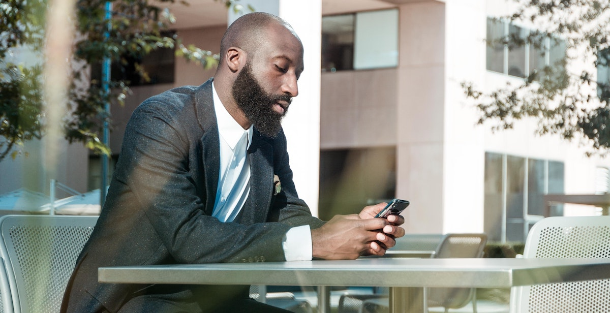 Picture of man looking at phone to illustrate Social Media Recruiting.