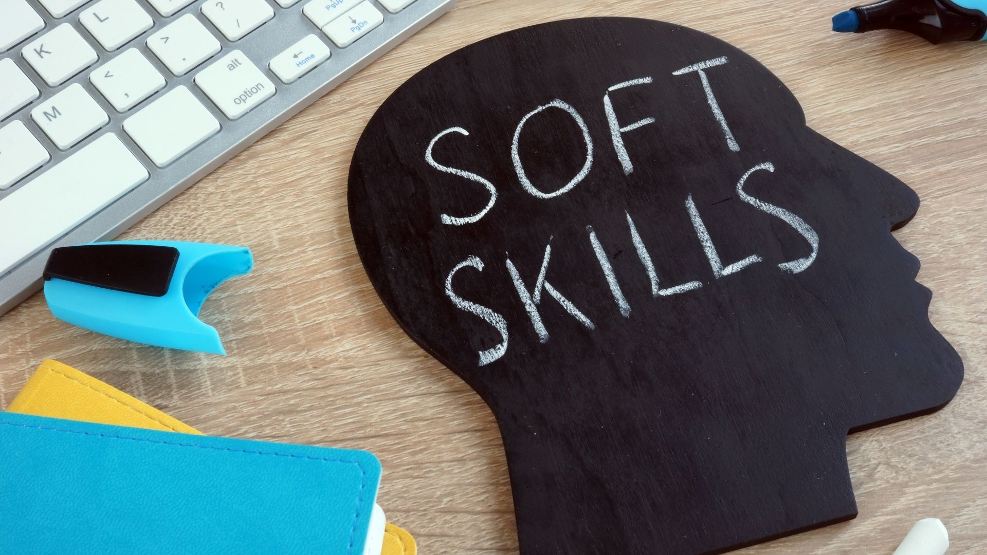 Photo of a head and computer keyboard to illustrate Soft Skills in the Workplace
