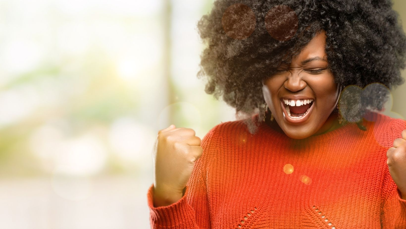 Photo of woman celebrating to illustrate entry level jobs.