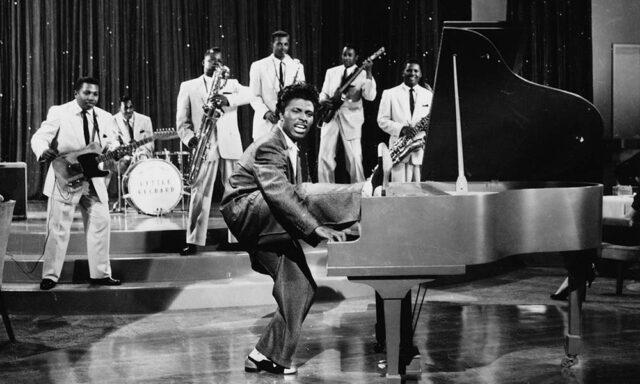 Little Richard with foot on piano