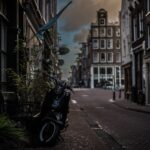 black-motor-scooter-parked-near-building-1329491