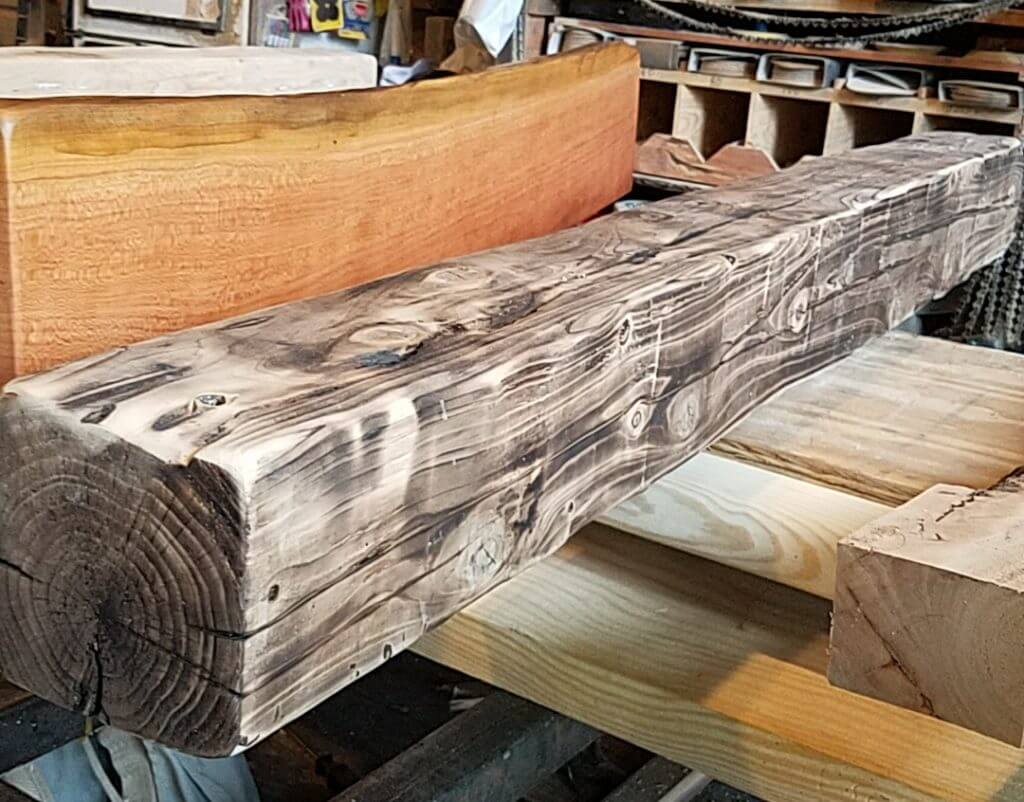 Hand hewn beams with a burnt edgeq