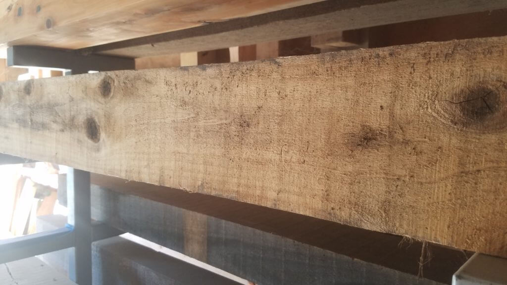 reclaimed large beam for a mantle