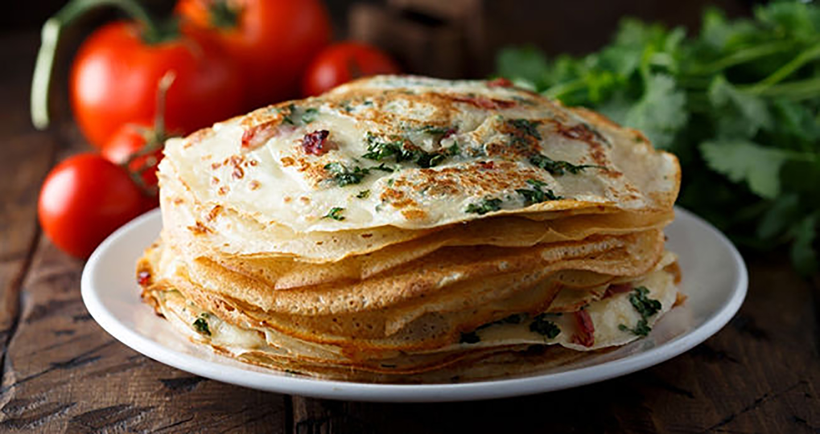 Directions:  Mix chickpea flour with water and egg Add the rest of the ingredients Cook pancakes on an iron skillet until light brown Serve with chutney or eat plain