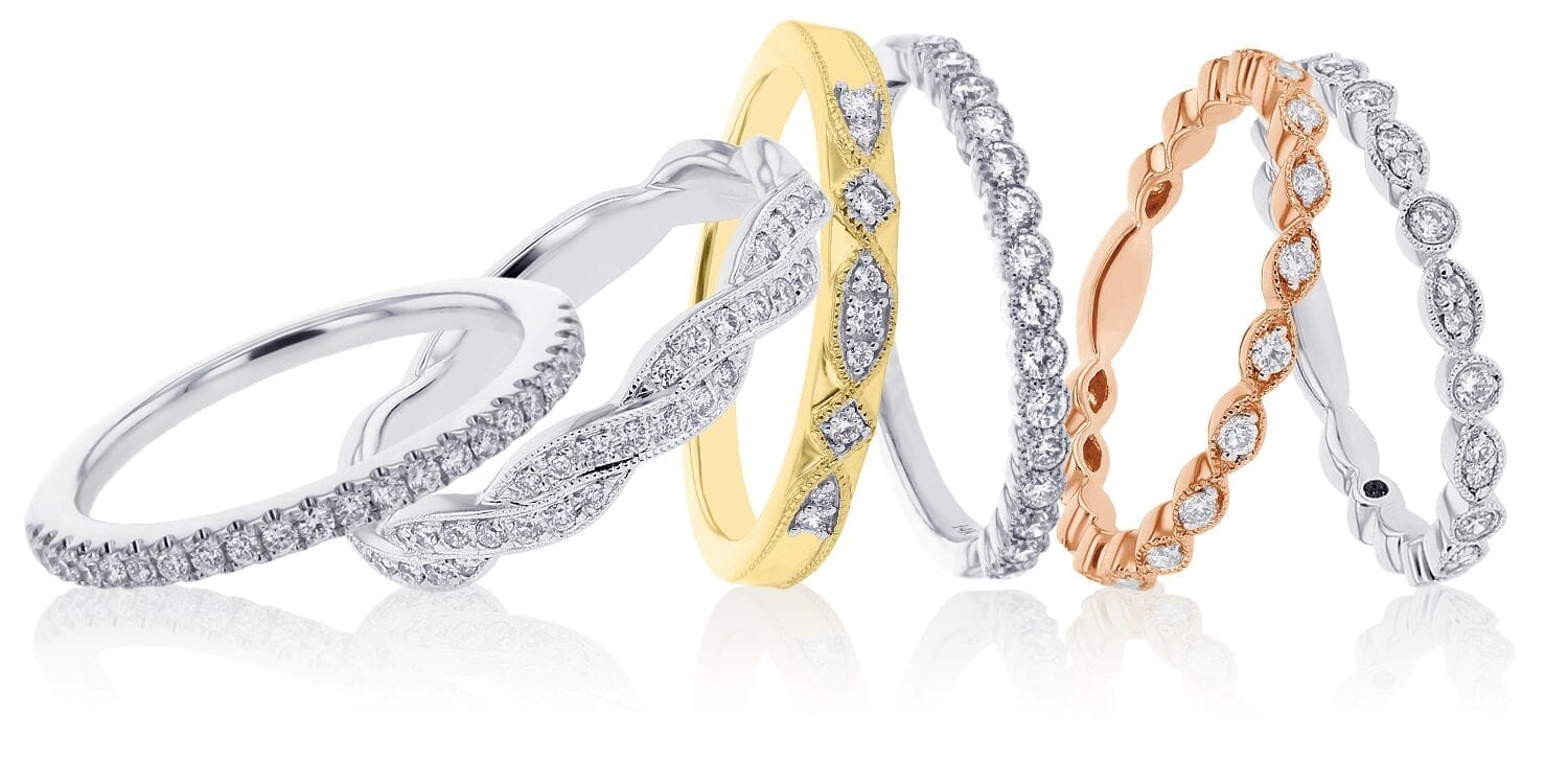 Six stackable diamond bands tilted in a line