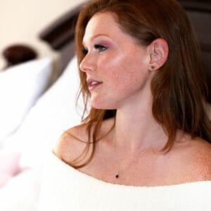 Kristin is wearing Get Naked Black Diamond Stud Earrings