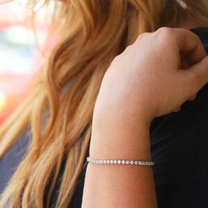 diamond tennis bracelet on lady's wrist