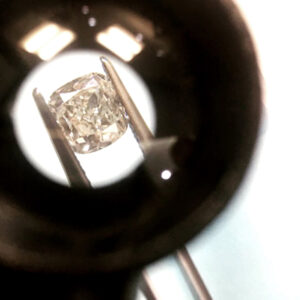 A picture of a diamond enlarged under a jeweler's loupe
