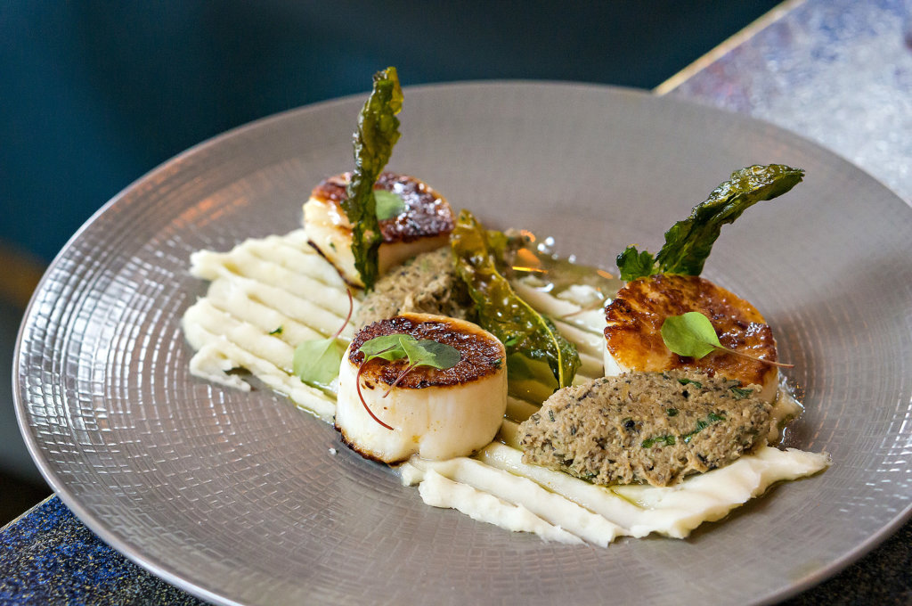 Seared scallops with mushroom duxelles and crispy kale